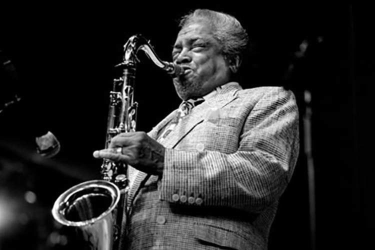"The late jazz tenor saxophonist Jean-Baptiste ""Illinois"" Jacquet, shown here at a 1998 concert at Brecon, Wales, is the focus at MTSU's 2019 Illinois Jacquet Jazz Festival set Thursday-Saturday, March 14-16. (Photo by William Ellis)"