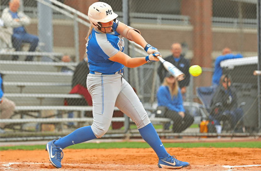 Lexi Cushing hits a softball.