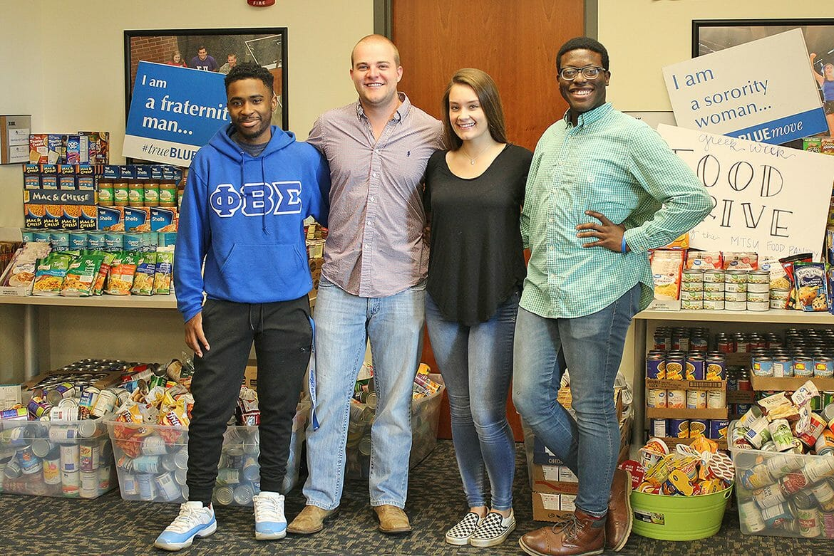 Some of the Greek Week committee members stand in front of the donations collected during MTSU Fraternity and Sorority Life's Greek Week food drive to benefit the MTSU Student Food Pantry. Pictured, from left, outside FSL's Student Union offices are MTSU sophomore Deshaun Covington, vice president of Phi Beta Sigma fraternity; senior Ramsey Ferguson, president of Alpha Tau Omega fraternity; junior Alex Revor of Chi Omega sorority; and senior Christian Nevils of Phi Kappa Tau fraternity. (Submitted photo)