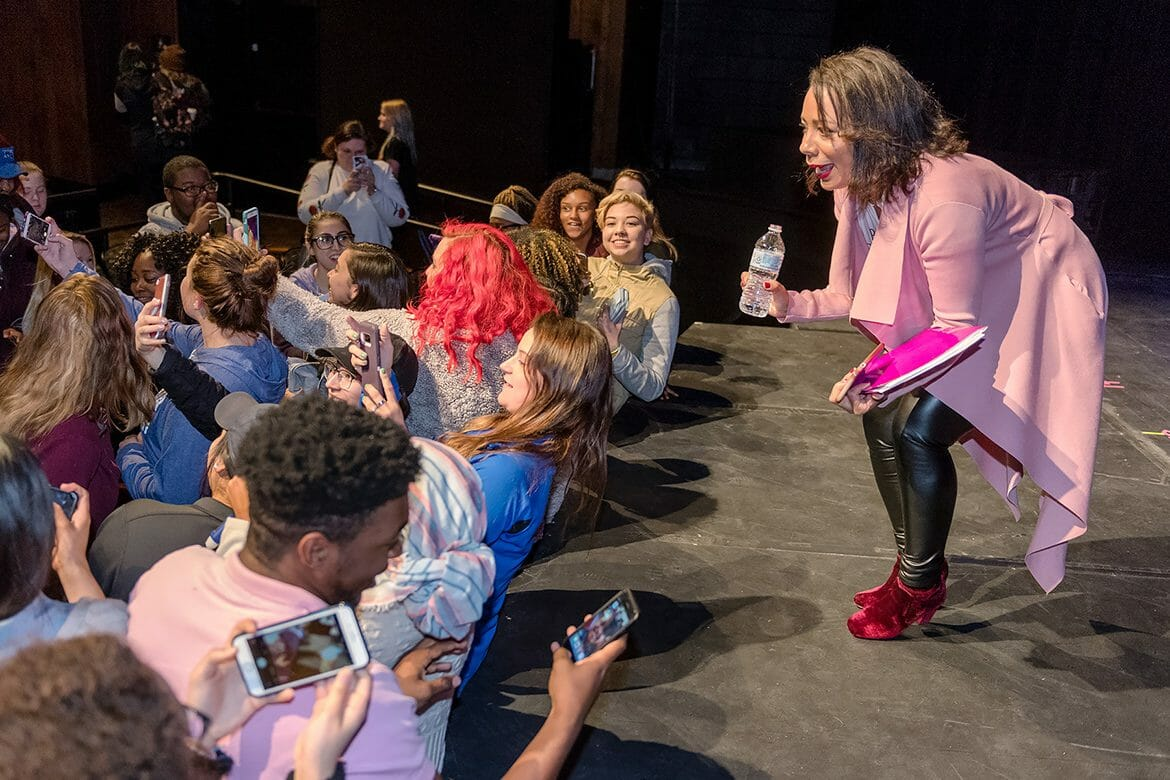 "At right, MTSU Women's History Month keynote speaker Selenis Leyva, one of the breakout stars of Netflix's hit series ""Orange Is The New Black"" squats down to accommodate student selfies following her remarks April 9 inside MTSU's Tucker Theatre. (MTSU photo by J. Intintoli)"