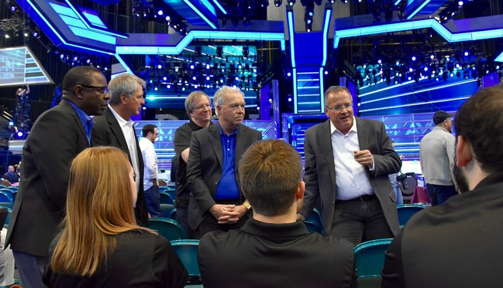 Academy of Country Music CEO and MTSU alumnus Pete Fisher, standing at right, holds a class Sunday, April 15, for five students from MTSU's Department of Media Arts on the floor of the ACM Awards Show at the MGM Grand Hotel and Casino's Grand Garden Arena in Las Vegas. From left, facing camera, are MTSU President Sidney A. McPhee, Media Arts Chair Billy Pittard, Media Arts professor Bob Gordon and College of Media and Entertainment Dean Ken Paulson. (MTSU photo by Andrew Oppmann)