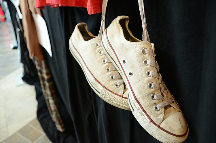 """A pair of white sneakers hangs on one of the panels of clothing shown recently during the """"What Were You Wearing?"""" sexual assault awareness exhibit on display April 2-6 in the MTSU Campus Recreation Center lobby. (MTSU photo by Jayla Jackson)"""