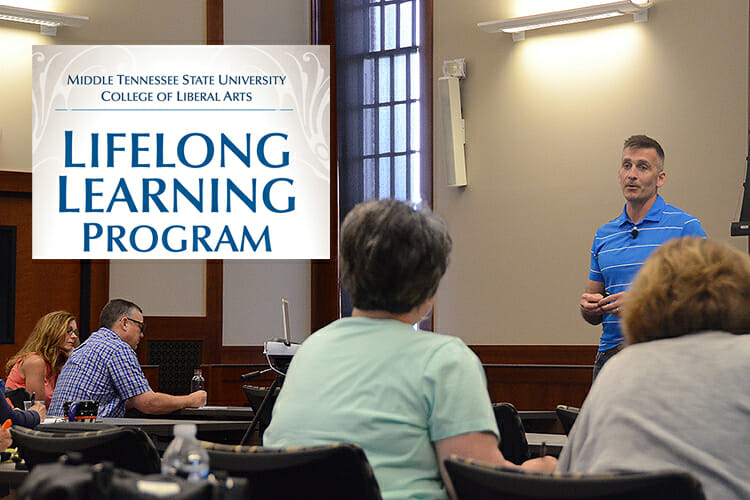 "MTSU aerospace associate professor Mark ""Nate"" Callender, standing right, makes a point May 23 during his lecture on God and science for this year's College of Liberal Arts Lifelong Learning Series held at the Sam Ingram Building's MT Center. (MTSU photo by Keundrea Simpson)"