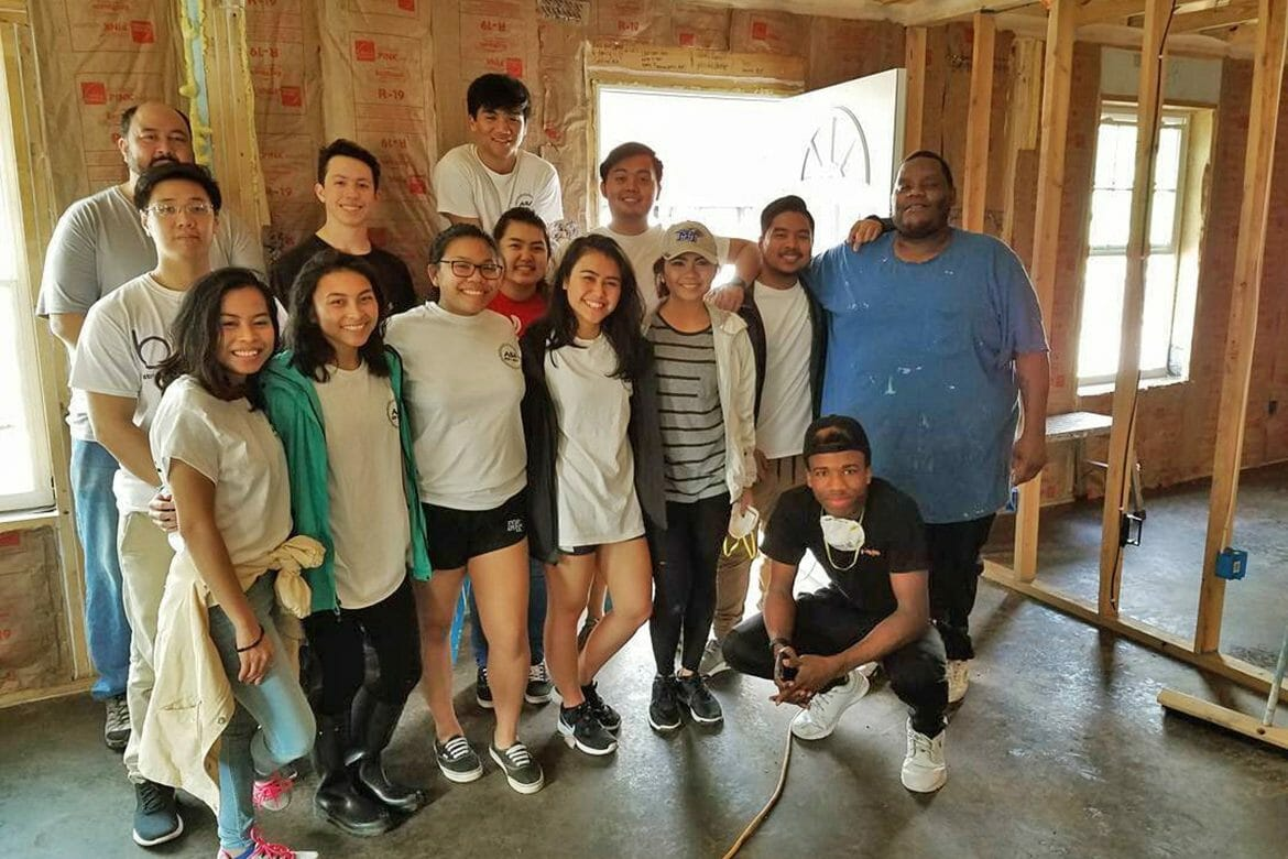 In this spring 2018 photo, members of the MTSU Asian Student Association and other volunteers pause for a photo during a Rutherford County Area Habitat for Humanity project. (Submitted photo)