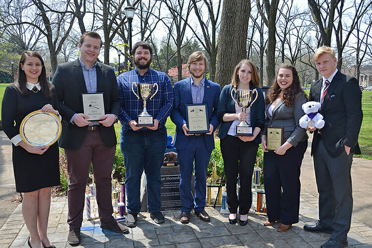 MTSU Debate Team members pose with some of the group's top national, regional and individual awards while wrapping up one of their best seasons ever in 2017-18. Shown from left are Skye Irish, a political science major from Rockwood, Tenn.; Steven Barhorst, an international relations major from Chicago; Joshua Hendricks, a communications studies major from Jefferson City, Tenn.; Alex Fingeroot, a history, political science and religious studies major from Nashville, Tenn.; Jordan Nickell, an interactive media and sociology major from Jackson, Tenn.; Katelyn Brooks, a fall 2017 graduate in anthropology and communications studies from Nashville; and Josh Tilton, an English major from Moscow, Russia. (MTSU photo by Jimmy Hart)