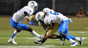 Mike Minter making a tackle.