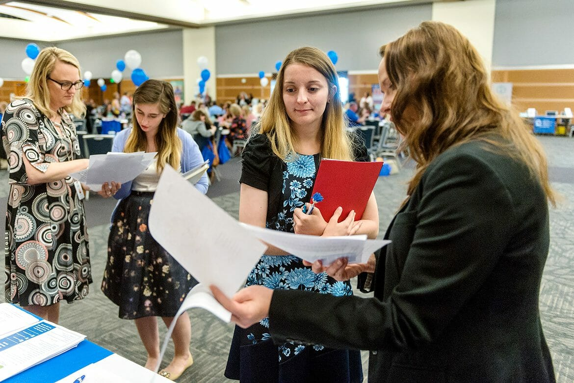 MTSU student teacher Cathy Sherriff, center, talks with Deanna Barnes of Wilson County Schools during the May 2 MTSU Student Teacher Recruitment Fair held in the Student Union Ballroom. (MTSU photo by J. Intintoli)