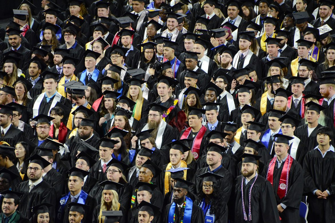 MTSU undergraduate students listen carefully to instructions Saturday, May 5, at the university's spring 2018 morning commencement ceremony in Murphy Center. MTSU presented a record 2,641 degrees — 425 graduate and 2,206 undergraduate — during the two-day event. (MTSU photo by GradImages.com)