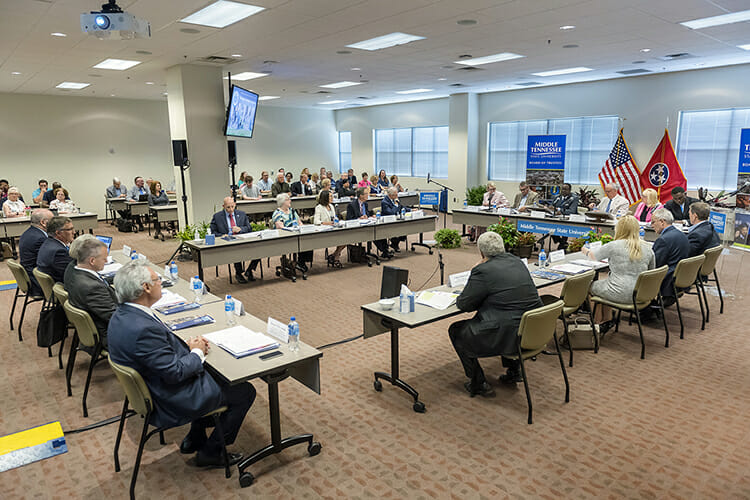 Members of MTSU's Board of Trustees listen carefully as university President Sidney A. McPhee, seated at the left of the U.S. flag, explains significance of Siemens Industry's $278 million software donation to the university's fast-growing mechatronics program Tuesday, June 12, at the summer 2018 trustees meeting in the Miller Education Center. The group also approved tuition and fee rates for the coming academic year, a 1.5 percent pay increase for employees and a plan to adjust salaries based on market, and plans to seek a building for the School of Concrete and Construction Management, and welcomed a new student trustee. (MTSU photo by J. Intintoli)