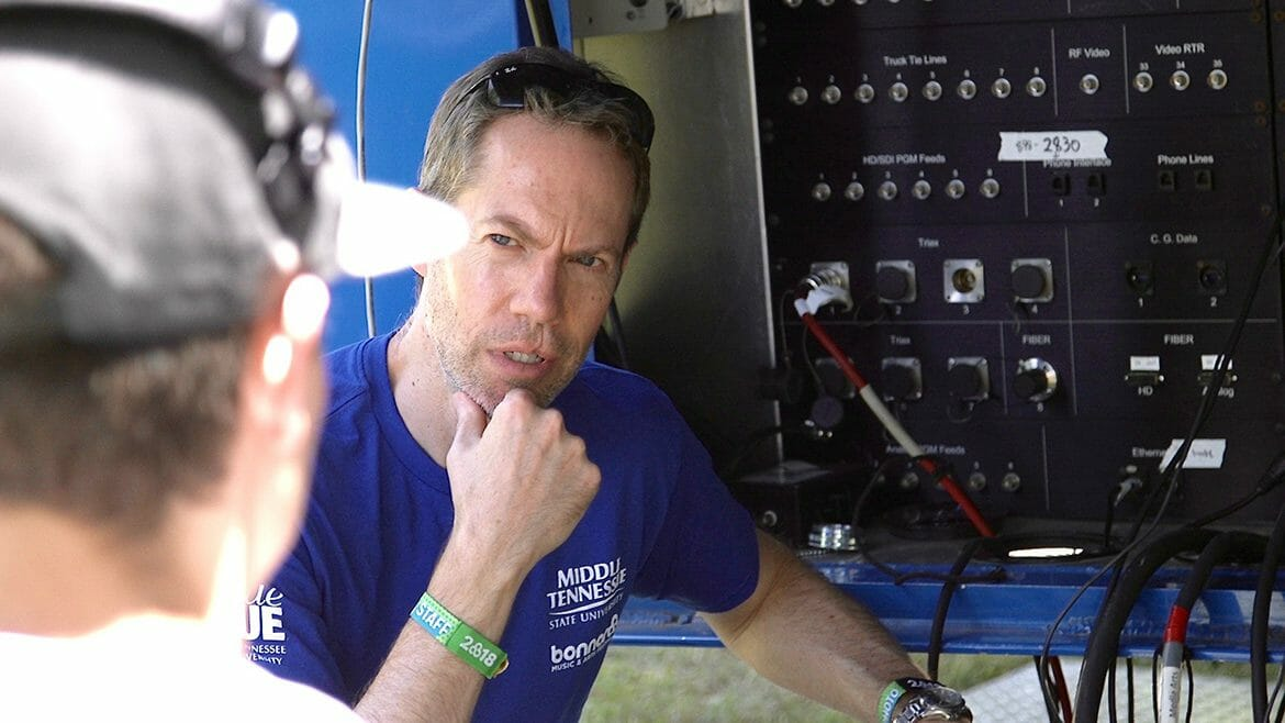 Michael Fleming, a professor in MTSU's Department of Recording Industry who teaches audio engineering, goes over procedures Saturday, June 9, with students from the College of Media and Entertainment who are capturing audio from the Who Stage at the 2018 Bonnaroo Music and Arts Festival in Manchester, Tenn. (MTSU photo by Rob Janson)