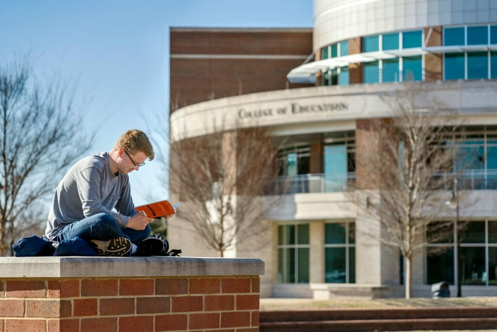 MTSU student, Joseph Jones, studying in front of the College of Education building. Photo by J. Intintoli.