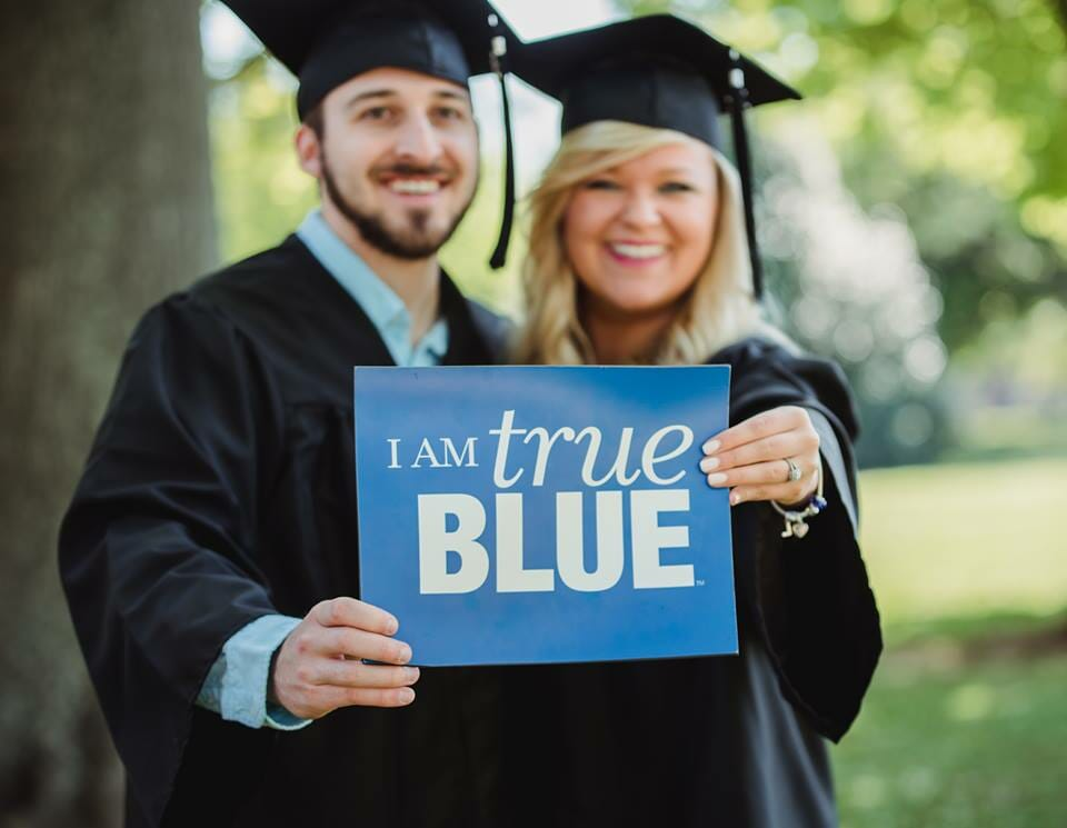 Former MTSU SGA president Lindsay Pierce and her fiance after graduation, holding an