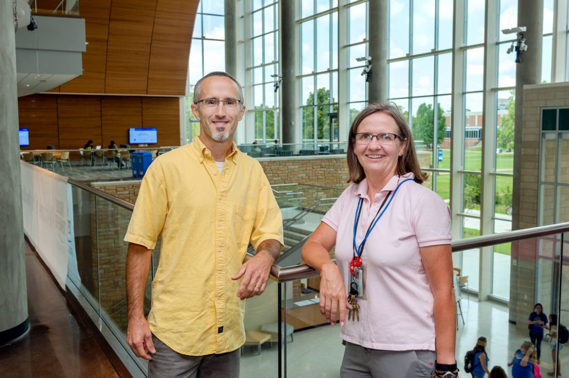 Frank Bailey, Biology faculty, and Amy Phelps, Chemistry faculty, standing on the second floor in the new Science Building for the ITD Communicator.