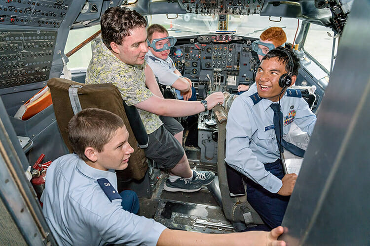 Cadets attending the 2018 Civil Air Patrol National Engineering Technology Academy check out the cockpit of the Boeing 727 owned by Middle Tennessee State University's Department of Aerospace and located at the Murfreesboro Airport. (MTSU photo by J. Intintoli)