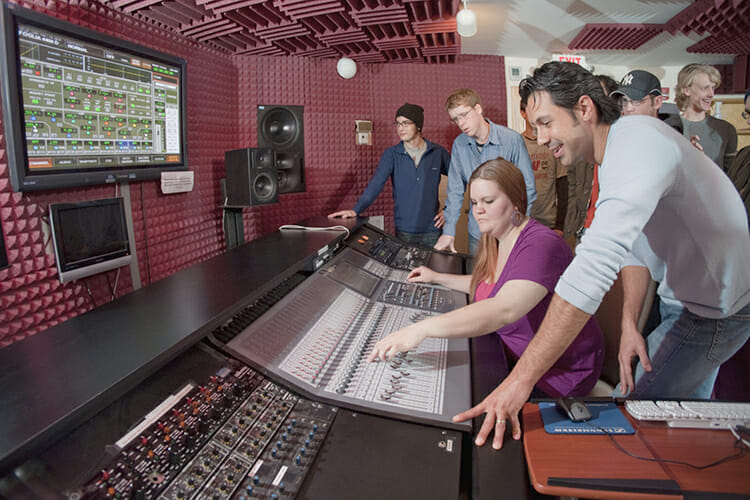 Department of Recording Industry professor Matt Foglia works with students in his audio production class inside Ezell Studio D, one of the fully equipped music recording and production studios for students in MTSU's College of Media and Entertainment. (MTSU file photo by Andy Heidt)