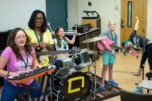A group of young rockers rehearse a song as one of their camp counselors listens proudly at the 2017 Southern Girls Rock Camp at MTSU. This year's camp, the 16th annual gathering, is set July 23-28 at the Wright Music and Saunders Fine Arts buildings. (File photo courtesy of Southern Girls Rock Camp)