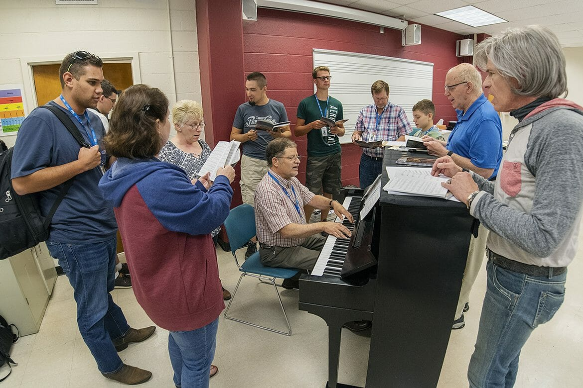 As students prepare to sing, Freddie Edwards of Cameron, Okla., seated, plays the accompaniment during a music theory class in the Wright Music Building at MTSU as part of the Ben Speer's Stamps-Baxter School of Music. This year's Southern Gospel music camp was held July 7-14. (MTSU photo by Andy Heidt)