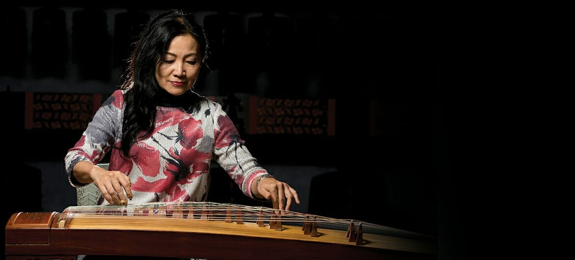 Dr. Mei Han, director of MTSU's Center for Chinese Music and Culture, plays the zheng, or ancient zither, in this photo for her album cover.