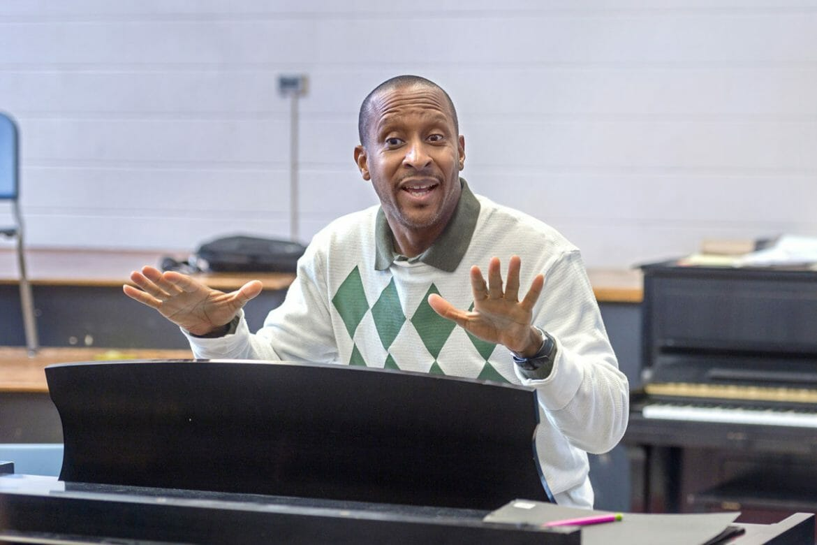 MTSU School of Music professor, Cedric Dent, instructing his class from behind a piano.