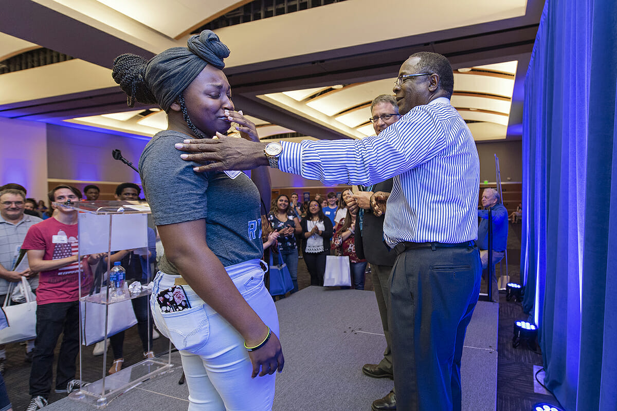 Now an MTSU freshman, Christan Lee, left, of Christiana, Tenn., and Centennial High School graduate, reacts with emotion after receiving a $2,500 scholarship to MTSU from Provost Mark Byrnes, center, and MTSU President Sidney A. McPhee while attending the Murfreesboro and Rutherford County True Blue Tour event in August 2018. MTSU kicks off the 2019 True Blue Tour campaign at 6 p.m. Wednesday, Aug. 21, in the Student Union Ballroom, the first of 14 tour stops this fall. (MTSU file photo by Andy Heidt)
