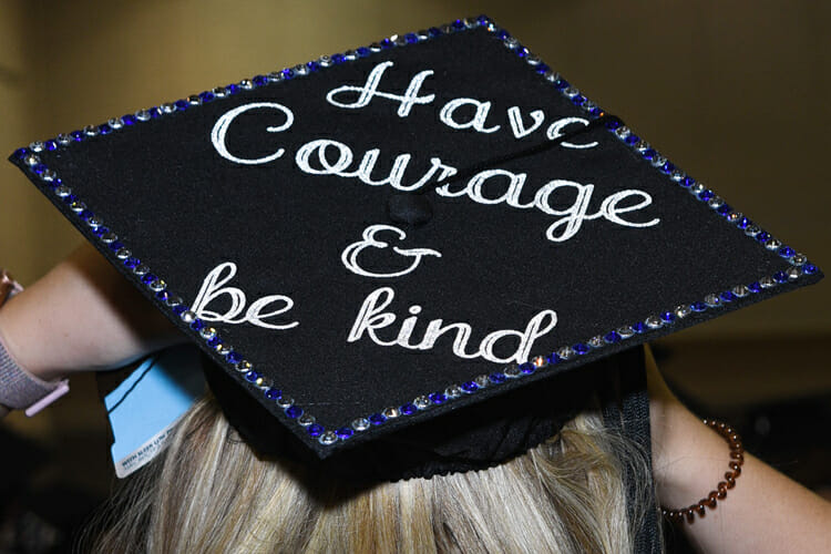 A summer 2018 MTSU graduate adjusts her personalized mortarboard as she prepares for the August commencement ceremony inside Murphy Center. MTSU will present degrees to 1,731 students during dual fall 2018 commencement ceremonies Saturday, Dec. 15. (MTSU photo by GradImages)