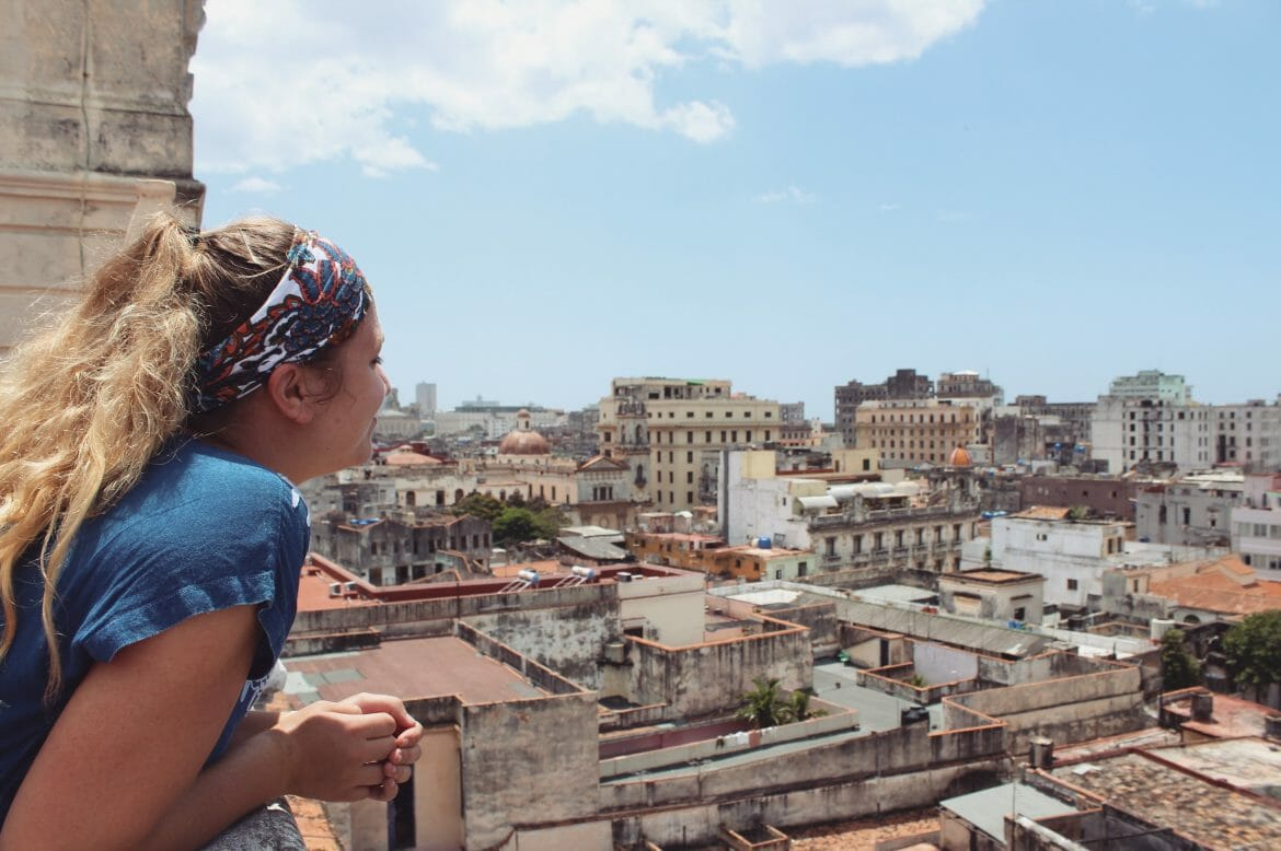 Abbey Van den Bosch overlooks a cityscape of Cuba.