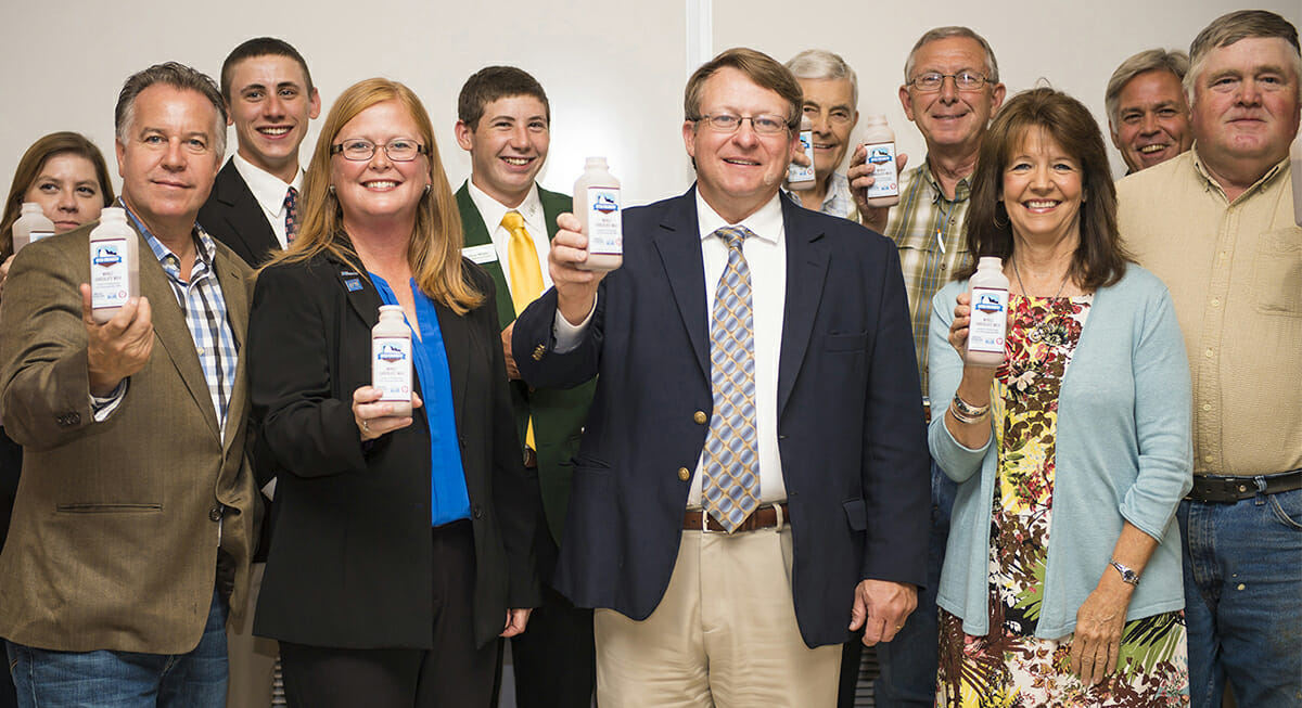 "Attendees ""toast"" the Tennessee Milk logo announcement for MTSU"