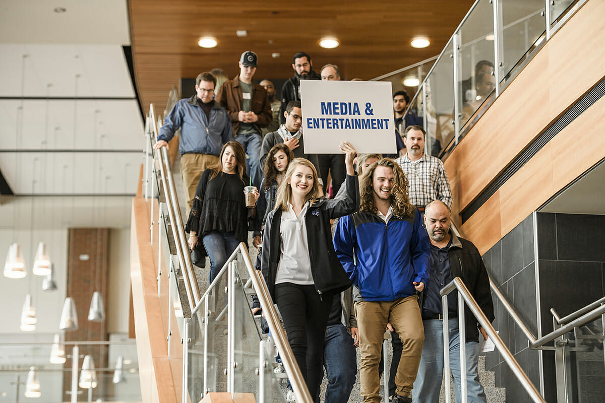 Prospective MTSU College of Media and Entertainment students head from the Student Union to another venue.