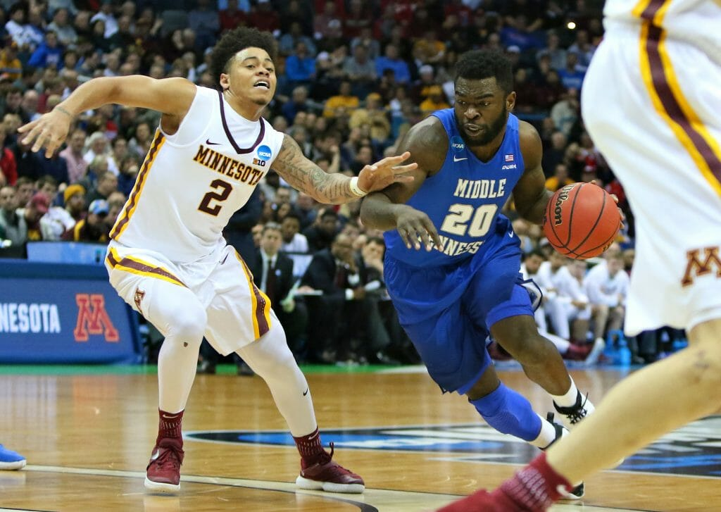 MTSU Men's Basketball guard, Giddy Potts, drives past Minnesota defender in March Madness upset win. Photo by Brent Beerends.