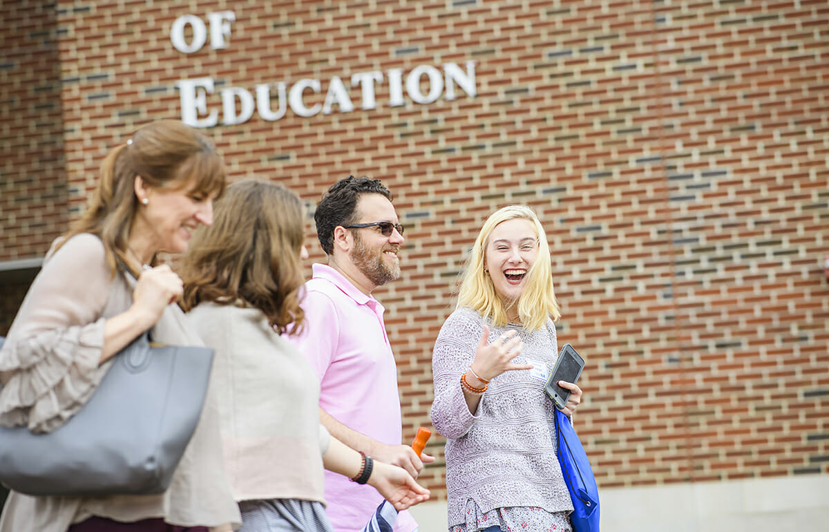 Prospective students and guests walk across the MTSU campus.