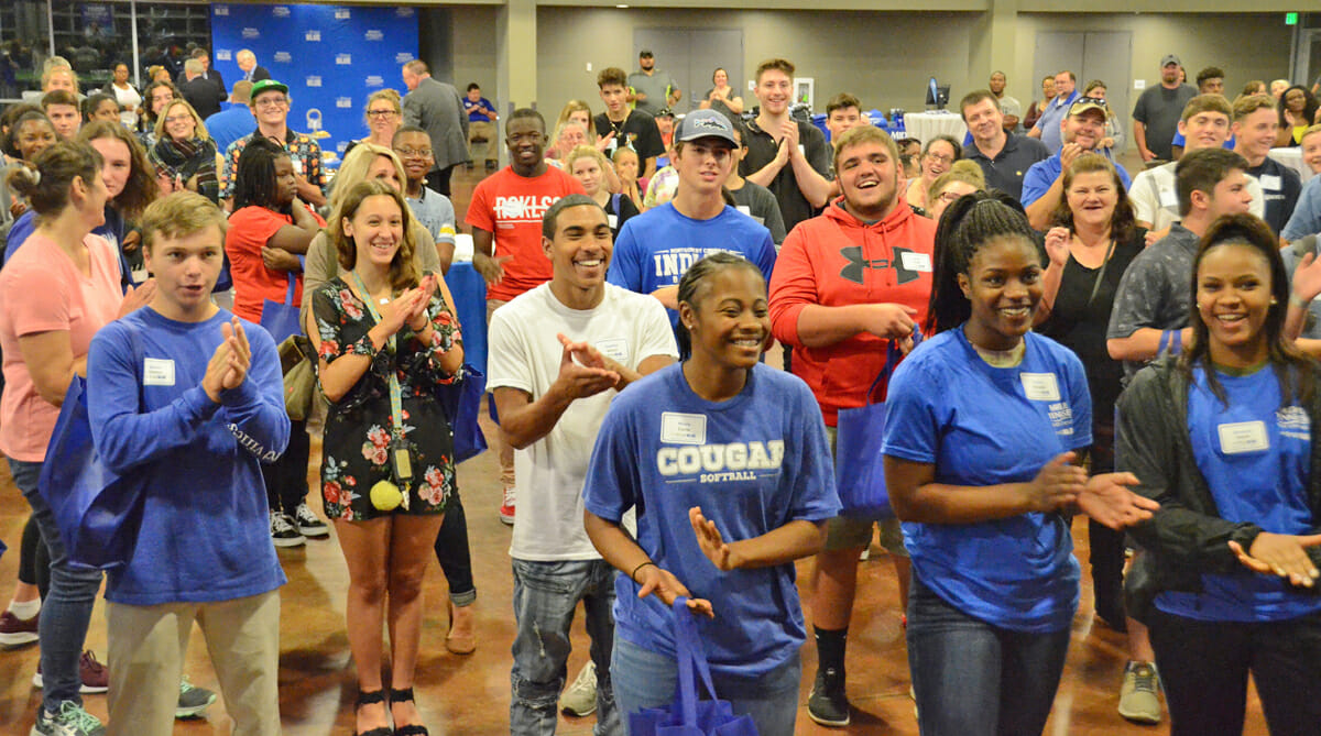 Students attending the MTSU True Blue Tour event in September 2018 in Clarksville, Tenn., show their approval for President Sidney A. McPhee's awarding of a scholarship and other giveaways. MTSU will bring the tour and an announcement of another guaranteed scholarship back to Clarksville Thursday, Oct. 10, with a luncheon for counselors and community college staff and 6 p.m. student reception, both at TownePlace Suites, 120 Fair Brook Place. (MTSU file photo by Randy Weiler)