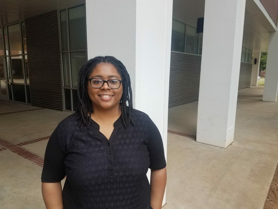 Dr. Nikki Jones standing in Peck Hall.