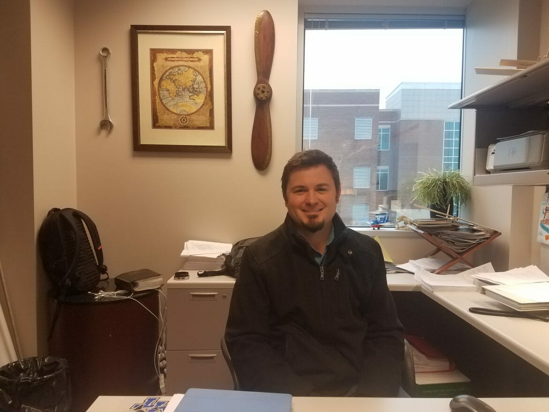 Tyler Babb, Aerospace professor, sitting in his office.