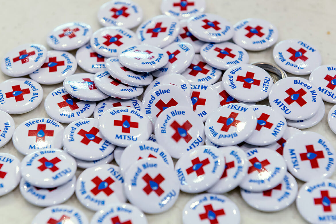 "A fresh pile of Connection Point collectible buttons awaits MTSU students who donated blood or volunteered at the annual ""Bleed Blue, Beat WKU"" drive in the university's Campus Recreation Center Oct. 30. MTSU won the competition with Western Kentucky for the sixth time with 603 pints of whole blood donated Oct. 29-31. (MTSU photo by J. Intintoli)"