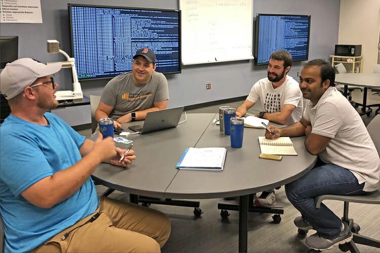"Pictured are some members of a team of MTSU students and mentors involved in a ""big data"" consulting project between the MTSU Data Science Institute and Nashville-based Hytch LLC, the social impact technology company behind the Hytch Rewards platform. Shown here in a campus classroom, from left, are Brandon Boshers, a Master of Science in Information Systems major with a concentration in Business Intelligence and Analytics; Rob Harrigan, Ph.D., who's mentoring the team and is a senior machine learning engineer within the Applied Machine Learning Group at CBS Interactive; Nick Matala, a Master of Science in Information Systems major with a concentration in Business Intelligence and Analytics; and Kiran Donthula, a doctoral student majoring Computational Science. (Submitted photo)"