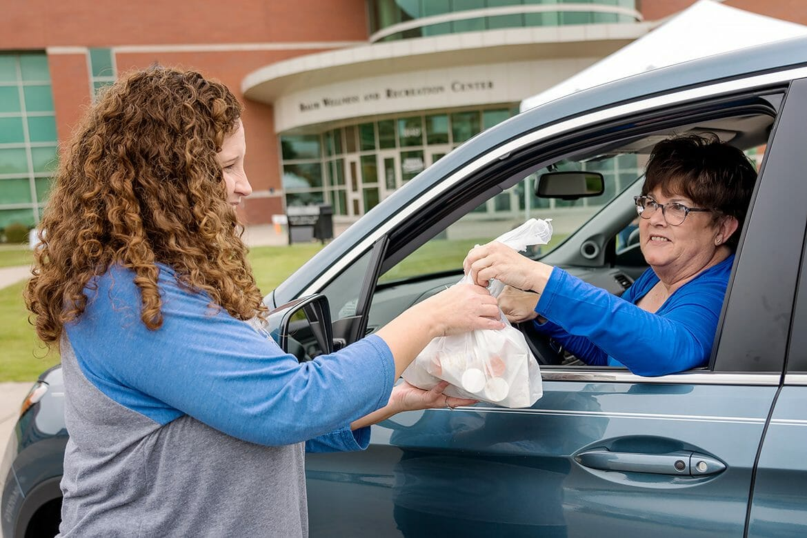 MTSU pharmacist Tabby Ragland, left, takes a bag of unwanted medications from Carolyn Powers, MTSU retiree, Thursday during the Campus Pharmacy/University Police drug take-back event at the Campus Recreation Center. This event is part of the Drug Enforcement Agency's overall efforts to remove excess drugs from communities where they could be abused or misused, diverted into the wrong hands or disposed of in environmentally unsafe ways. (MTSU photo by J. Intintoli)