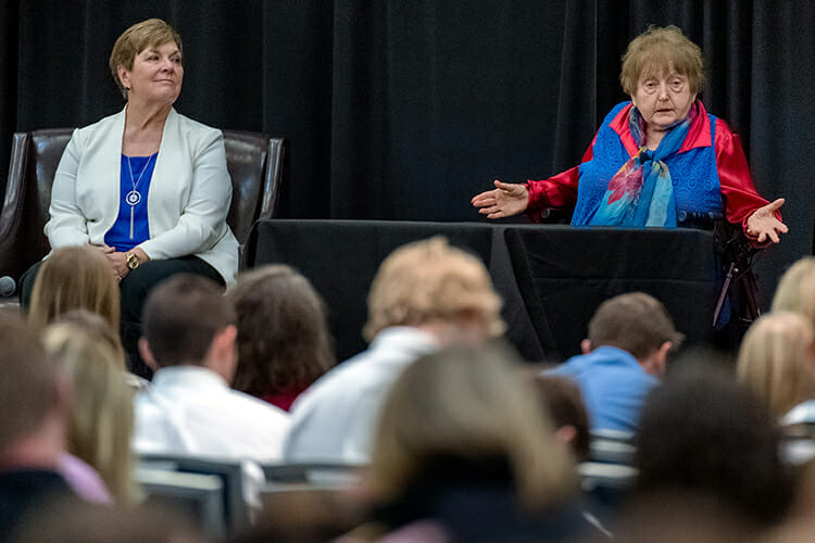"Holocaust survivor Eva Moses Kor, right, makes a point during her Oct. 30 address at MTSU's Holocaust Education Day commemoration in the Student Union Building. At left is Jill Coble, Tennessee Holocaust Commission teacher fellow and panel moderator. MTSU's Jewish and Holocaust Studies Program, the Tennessee Holocaust Commission and the MTSU Department of English sponsored the Holocaust Conference keynote featuring Kor, co-author of ""Surviving the Angel of Death"" with Lisa Rojany Buccieri. Kor and her identical twin, Miriam, were held captive in the notorious Auschwitz death camp and survived sadistic genetic experimentation by the Nazis. (MTSU photo by J. Intintoli)"