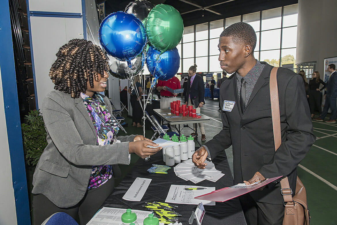 MTSU senior DeShawn Dyson, right, speaks with Ciera Franklin of Nashville General Hospital during the 2018 Fall Career Fair held Wednesday, Oct. 24, at Murphy Center. The event drew several hundred students and alumni and more than 150 employers and graduate/professional schools. (MTSU photo by Andy Heidt)