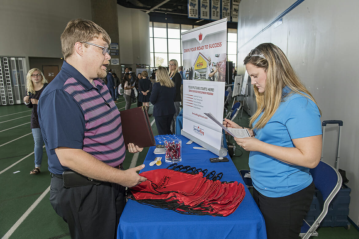 MTSU alumnus Randall Crockett, left, speaks with Natasha Long with Service King during the 2018 Fall Career Fair held Wednesday, Oct. 24, at Murphy Center. The event drew several hundred students and alumni and more than 150 employers and graduate/professional schools. (MTSU photo by Andy Heidt)