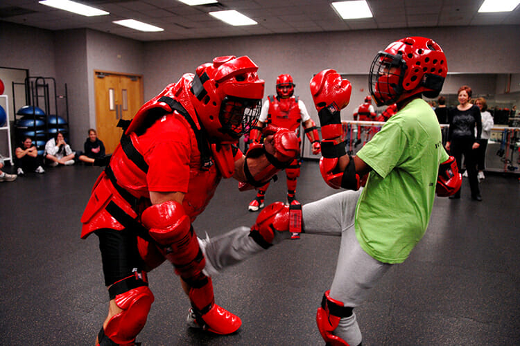 A Rape Aggression Defense Systems instructor, wearing red protective gear, tangles with a student during a RAD course at Luke Air Force Base, Arizona, in this file photo. The MTSU Police Department is again teaching the basic RAD course this fall for the campus community beginning Tuesday, Oct. 16, and is expanding the course offerings to include Aerosol Defense Options and Advanced Self Defense, too. (U.S. Air Force photo courtesy of Airman First Class David Bulkley/Luke AFB)