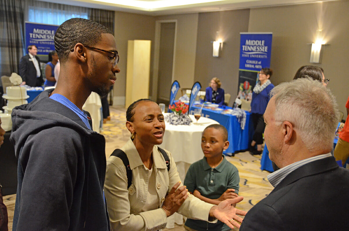 Ken Paulson, right, president of the Freedom Forum's First Amendment Center at MTSU, listens as Teresa McKenzie, second from left, asks questions about the variety of programs within the college. Ryan McKenzie, 17, a junior at Arabia Mountain High School in Lithonia, Ga., listens during the MTSU True Blue Tour visit at the Hyatt Regency Perimeter in Atlanta, Ga., in October 2018. Also shown is Rance McKenzie, 9. Ryan McKenzie won a $1,500 scholarship. MTSU and the tour return to Atlanta Wednesday, Oct. 30. (MTSU file photo by Randy Weiler)