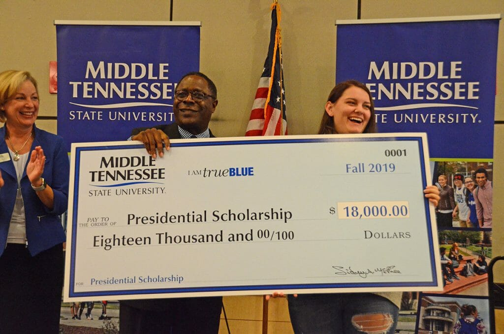 Sidney A. McPhee and Presidential Scholarship recipient Paige Dunny