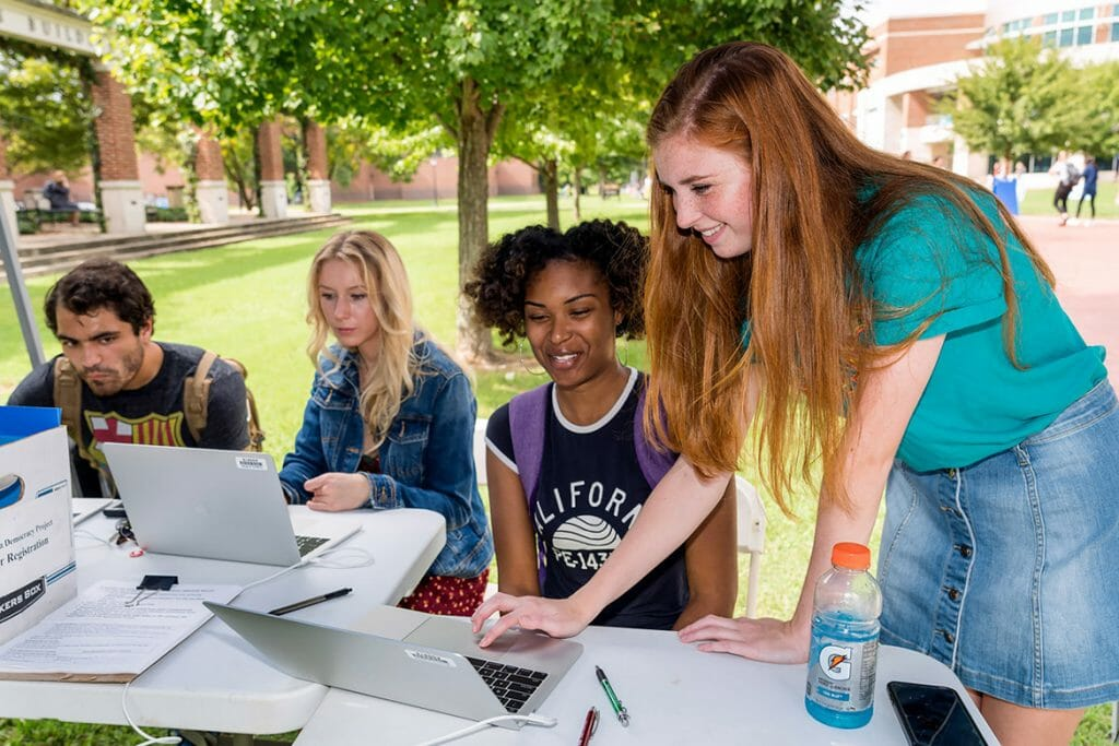 From left, Sam DeLoach, Christy Fell and KeWana McCallum register to vote assisted by volunteer Shelby Ziegler of Alpha Chi Omega sorority outside the University Honors Building Oct. 9. (MTSU photo by J. Intintoli)