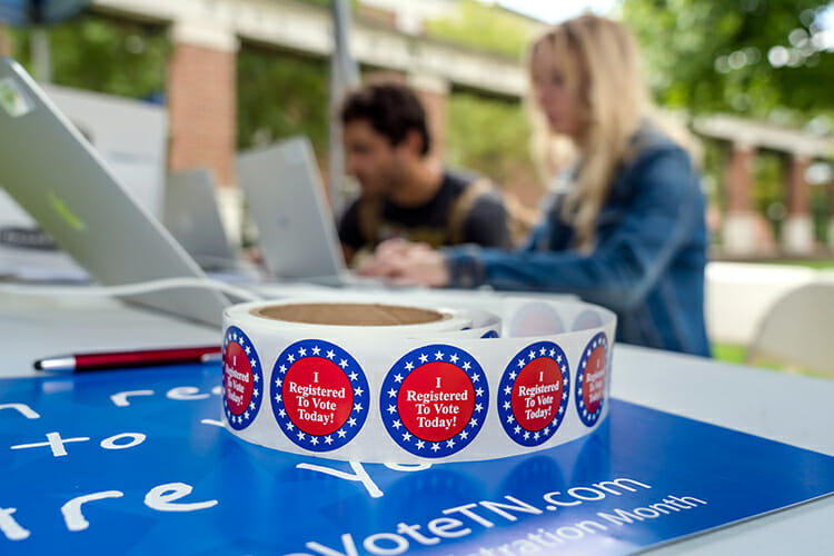 """""""I Registered To Vote Today!"""" stickers await MTSU students registering to vote outside Peck Hall during the Oct. 8-9 registration push. Their efforts pay off Tuesday, Nov. 6, when local and federal midterm elections are being held. (MTSU file photo by J. Intintoli)"""