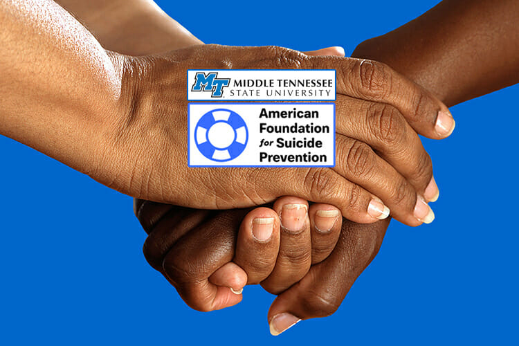 pair of supportive hands clasped together with the MT horizontal logo and American Foundation for Suicide Prevention logo superimposed atop them