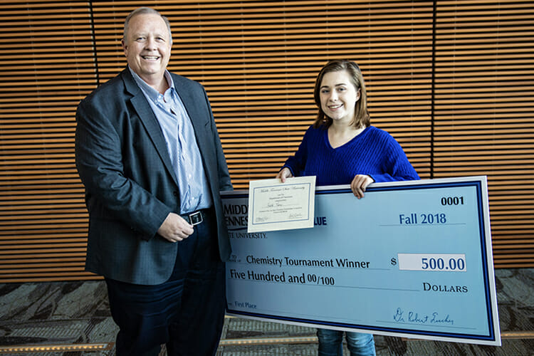 MTSU College of Basic and Applied Sciences Dean Bud Fischer, left, presents Faith Viers of Central Magnet School in Murfreesboro with a $2,000 scholarship to attend MTSU and $500 for earning first place honors in the Nov. 26 Chemistry Scholarship Tournament in the Science Building. (MTSU photo by Eric Sutton)