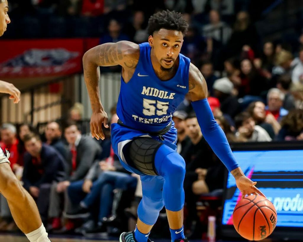 Antonio Green, MTSU Men's Basketball, drives past Belmont defender. Photo by MT Athletics.