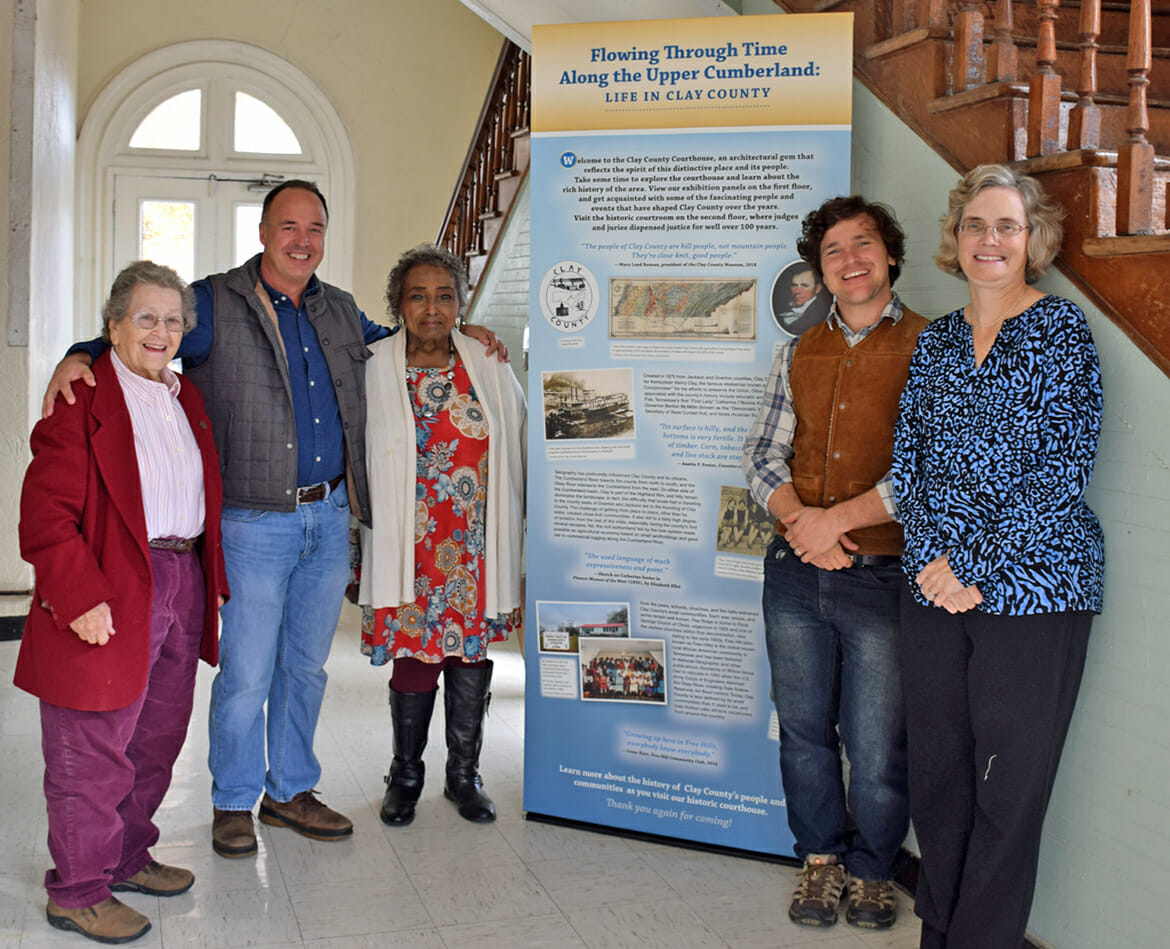 "Display panels in the ""Flowing through Time in the Upper Cumberland: Life in Clay County"" exhibit were installed at the Clay County Courthouse Nov. 5. Pictured, from left, are Mary Loyd Reneau, Clay County Museum director; Mark Dudney, historic preservation planner, Upper Cumberland Development District; Mary Lean Bartlett, president, Free Hills Community Center; Harris Abernathy, graduate student, MTSU Center for Historic Preservation; and Antoinette van Zelm, assistant director, Center for Historic Preservation. (Photo submitted)"