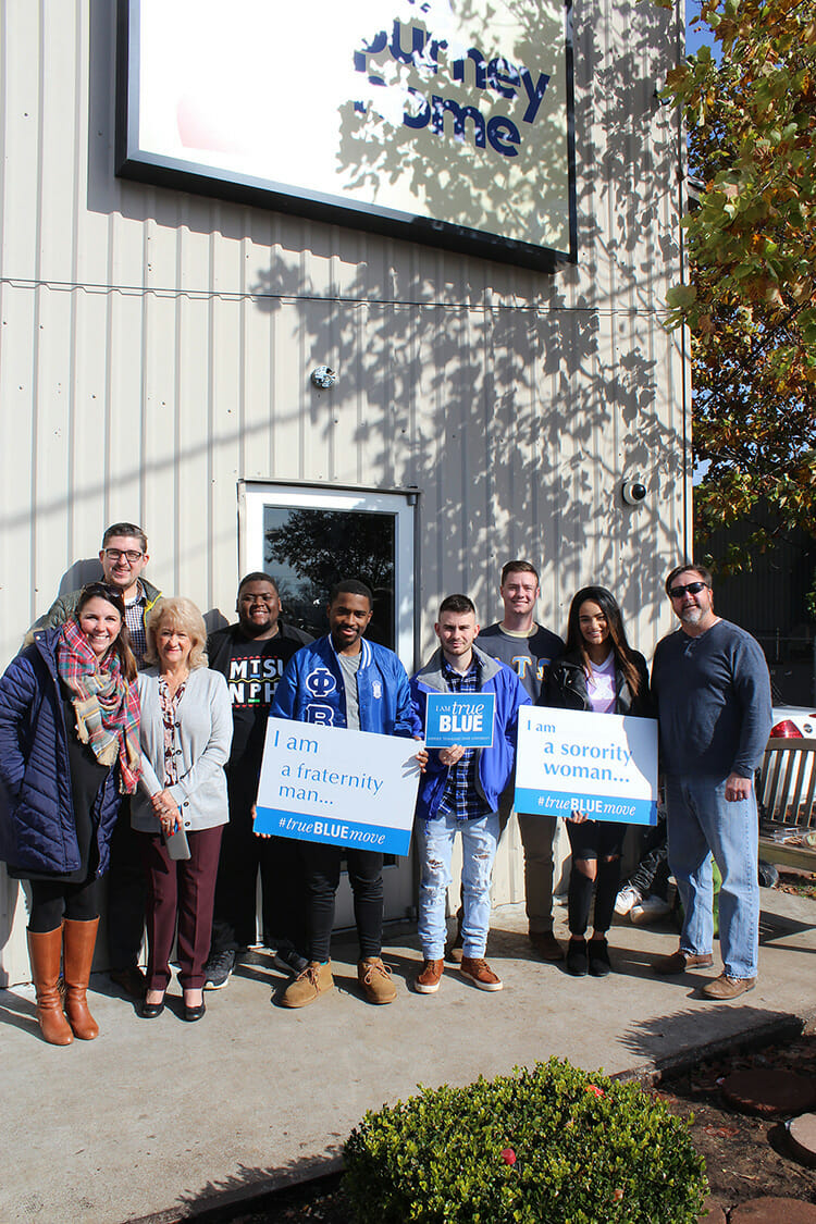 "MTSU Fraternity and Sorority Life recently donated $2,478.17 to The Journey Home. The money was raised through a three-day collection in September called ""Crash the Commons Change Wars."" Pictured are FLS staff and students with staff of The Journey Home outside its location on West Castle Street. (Submitted photo)"
