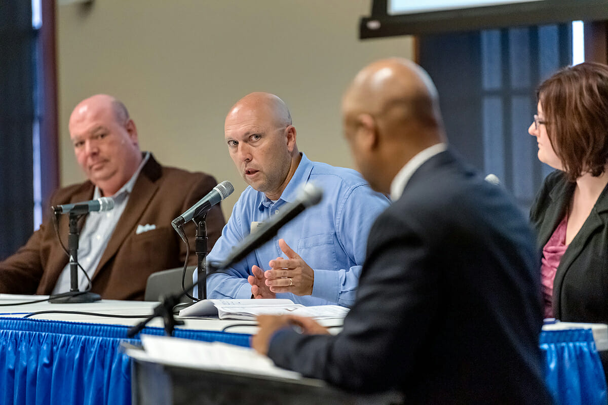MTSU Tennessee STEM Education Center Director Greg Rushton, second from left, shares his experience with engaging enthusiastic students in the classroom during a recent panel discussion, sponsored by Texas Instruments and held at MTSU, to promote STEM education. From left are Scott Eddins, a mathematics strategy and support coordinator with the Tennessee Department of Education; Rushton; Dr. Maria Danielle Garrett, a Belmont University chemistry professor; and moderator Alfred Hall of the University of Memphis. (MTSU photo by J. Intintoli)